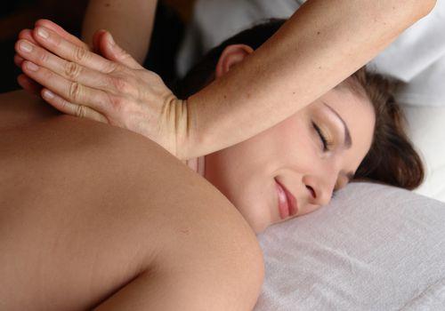 Woman receiving deep tissue massage
