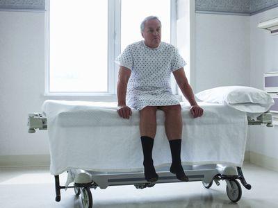 senior man in hospital gown