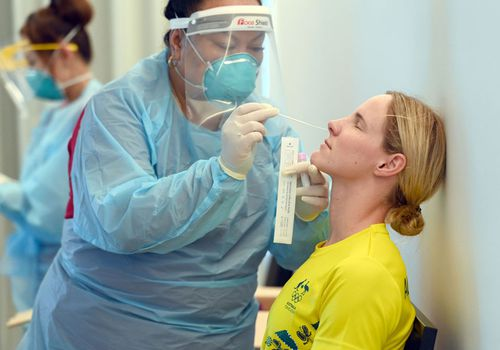 Australian swimmer getting tested for COVID-19