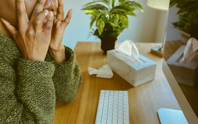 Woman Suffers Sinus Pain While Working on Desktop Computer