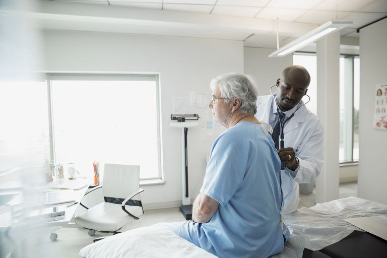 Physician checking out patient