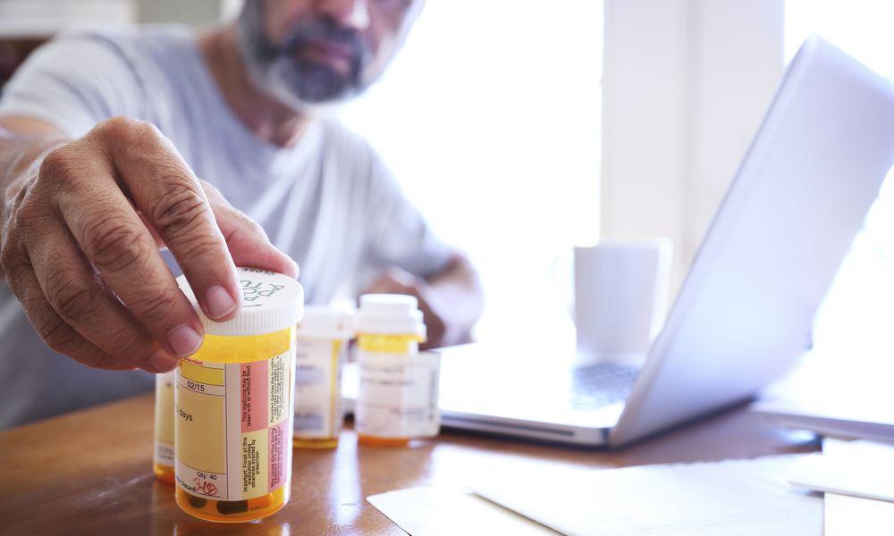 man reaching for prescription
