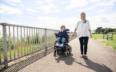 Child in wheelchair and woman enjoying a day out