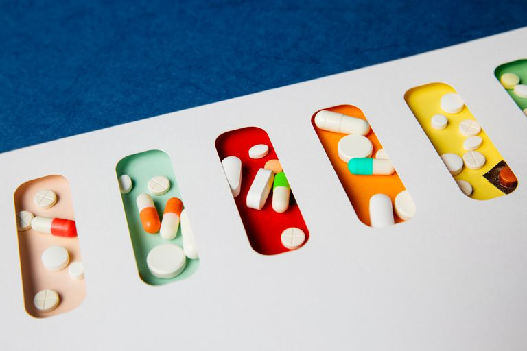 Pills laid out on colorful backgrounds
