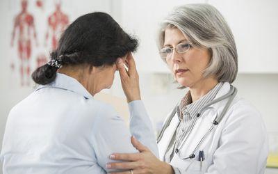 Doctor examining patient in office