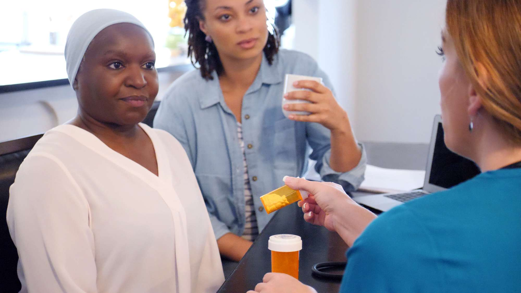 A woman with cancer receiving her medicine