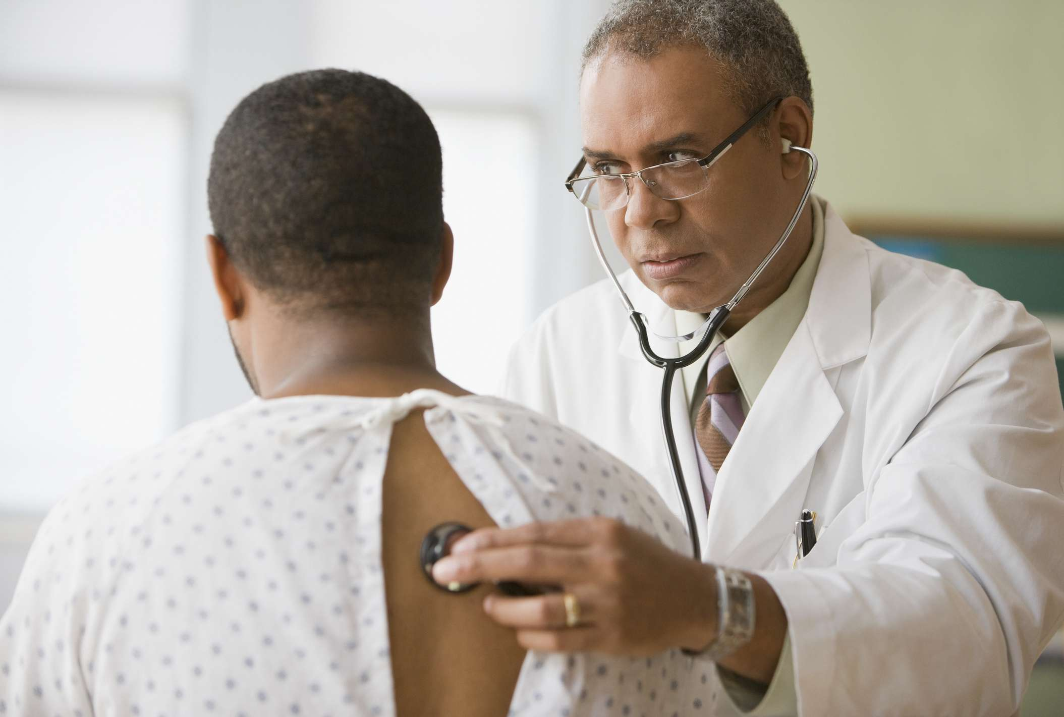 Doctor examining patient's lungs