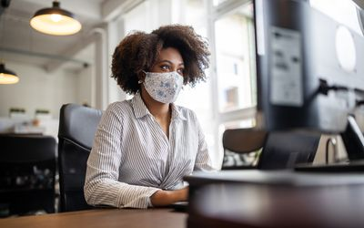 Person wearing a mask at work
