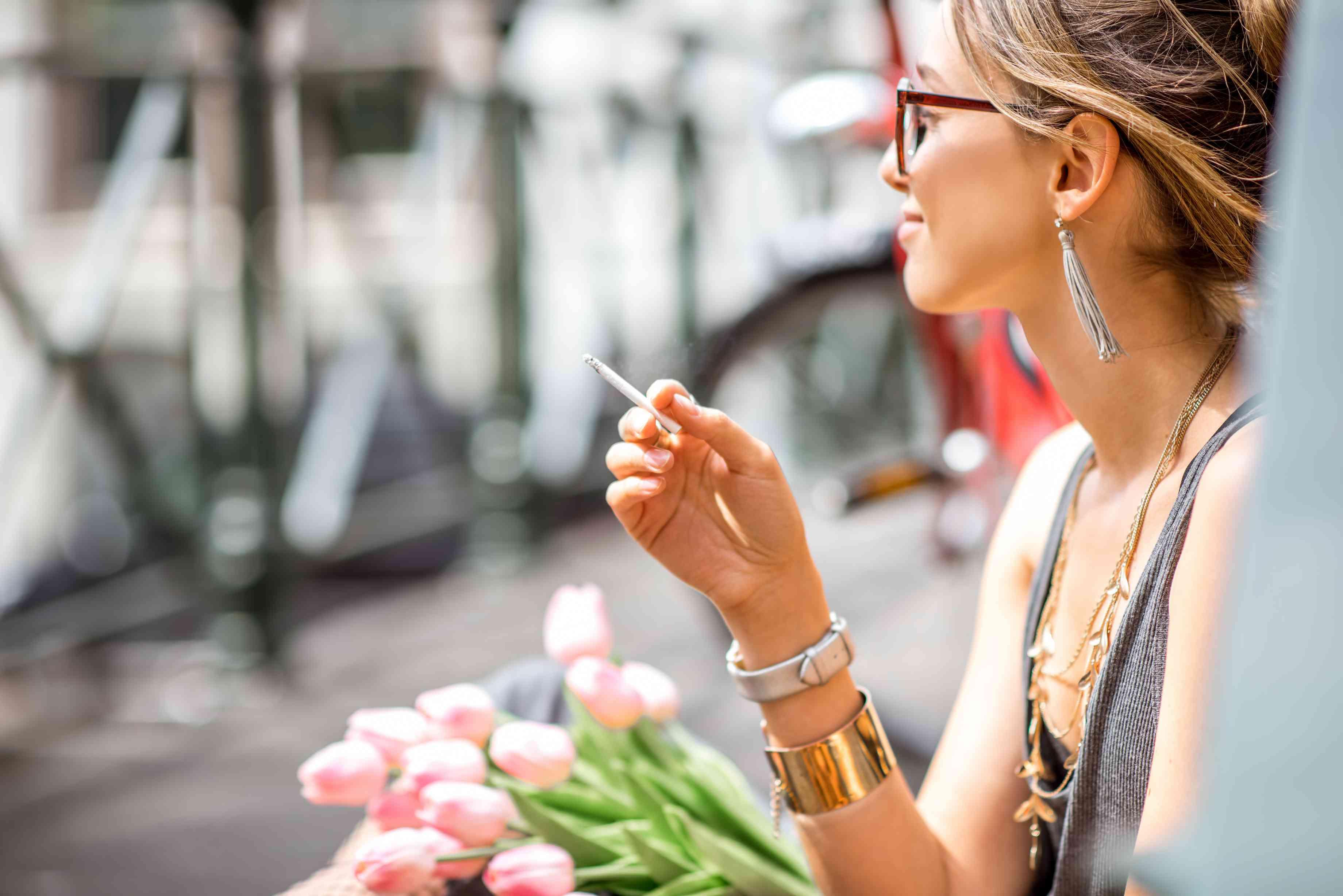 Woman smoking in Amsterdam city