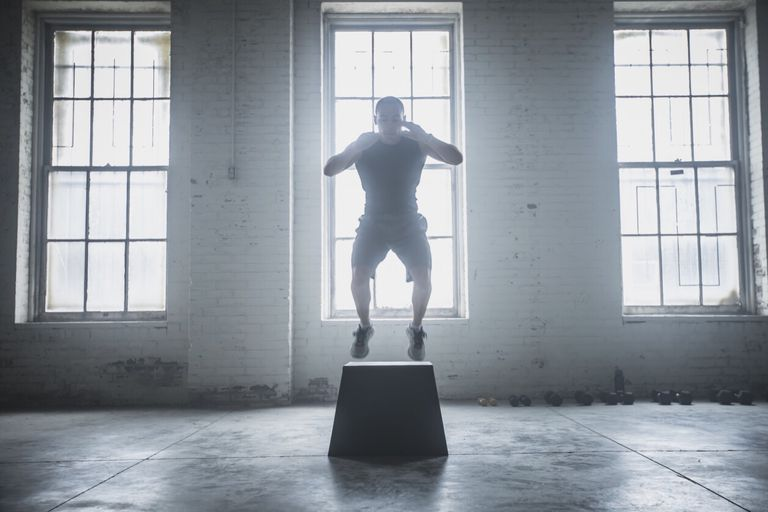 Photo of an athlete doing a box jump.