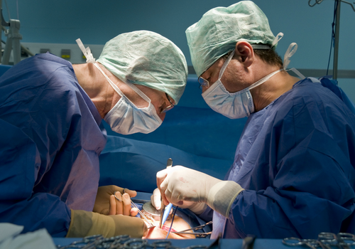 Two spine surgeons operating.