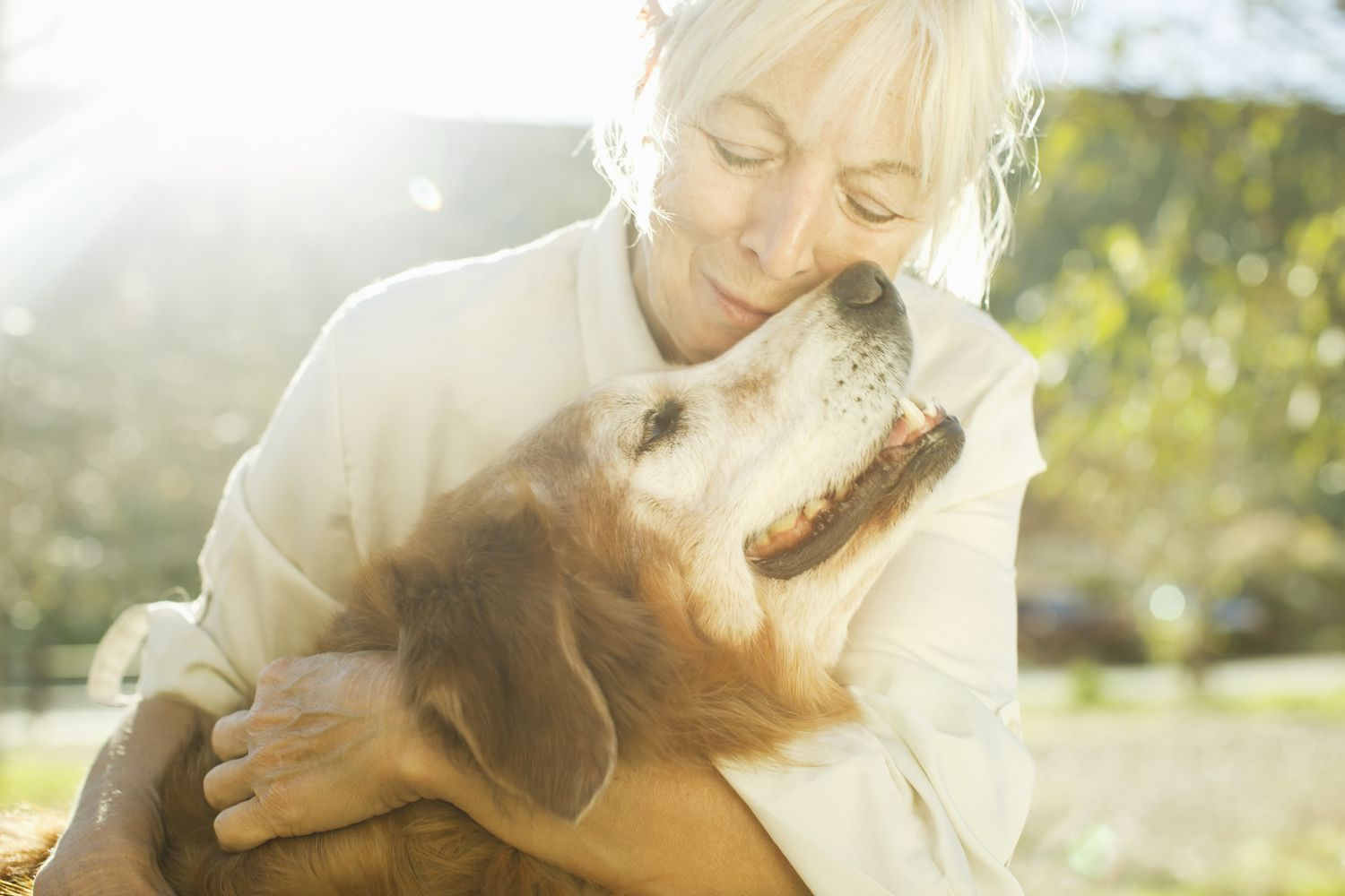 Woman and her dog on a sunny day