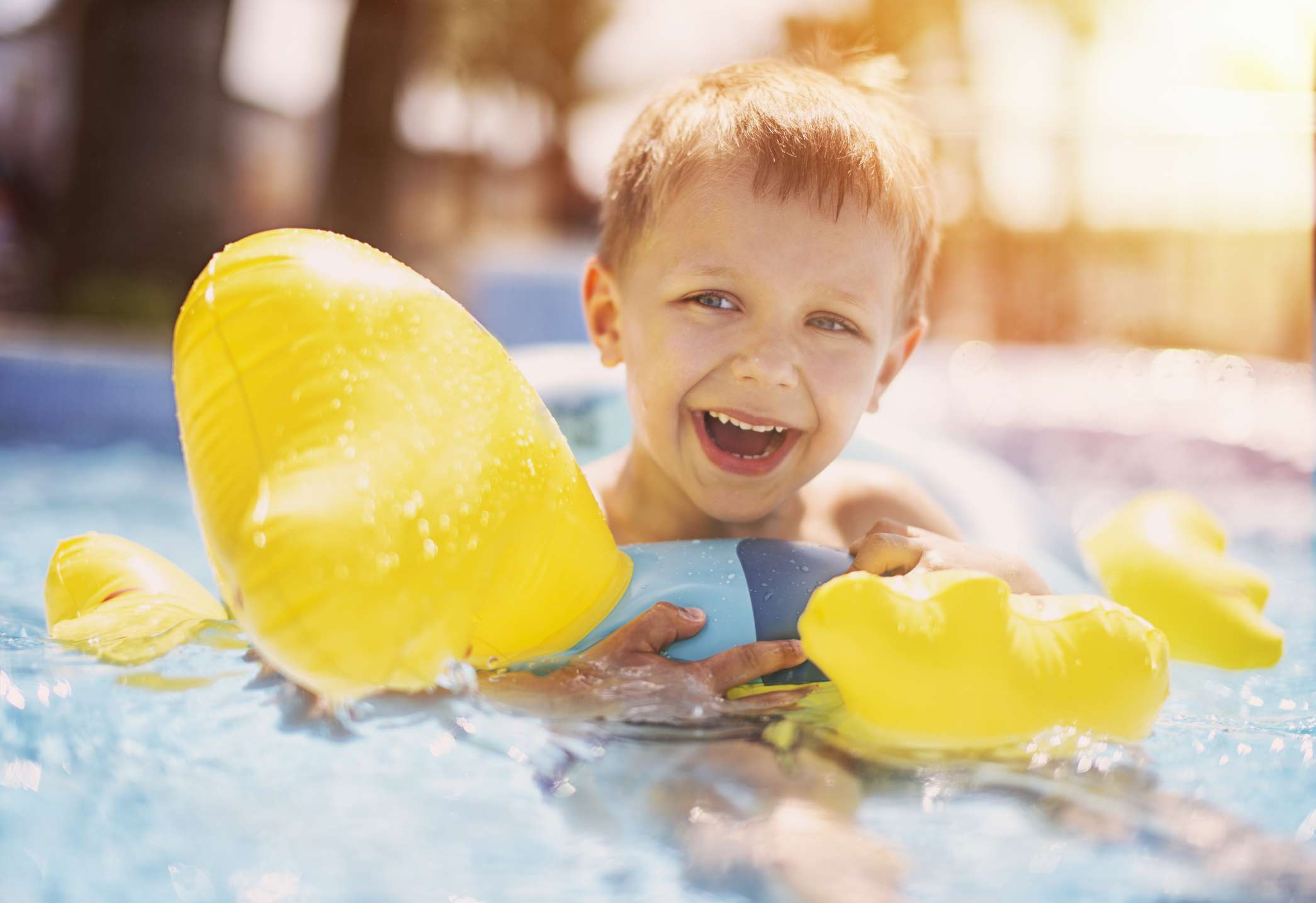 Boy in inner tube floating in pool