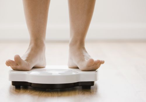 Person standing on a bathroom scale