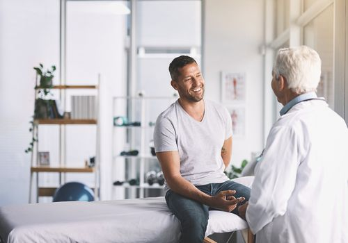 Man talking with his doctor about lung cancer in men