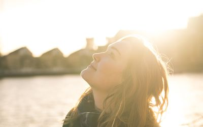 A woman basking in the sunlight