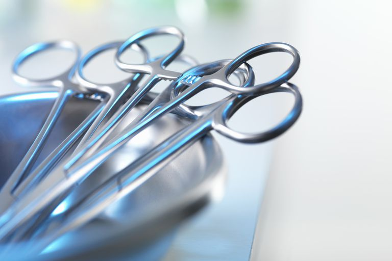 Medical instruments sit in a tray.