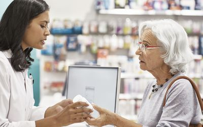 woman receiving arthritis medication from a pharmacist