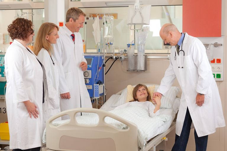 A team of doctors examining a patient.