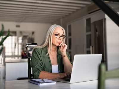 Worried senior woman using laptop