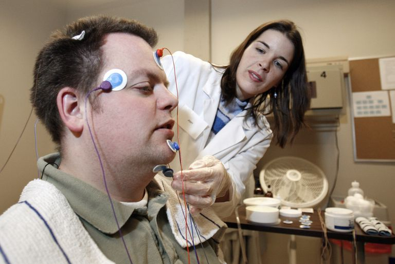 Technologist Applying Sensors To Patient For Sleep Study