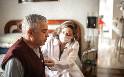 doctor listening to person's heart