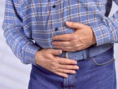Man holding belly for hernia pain