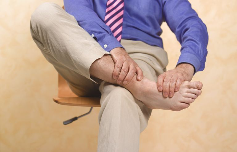 Man holding his ankle in pain