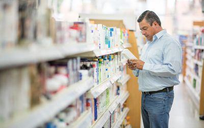 man shopping at a pharmacy
