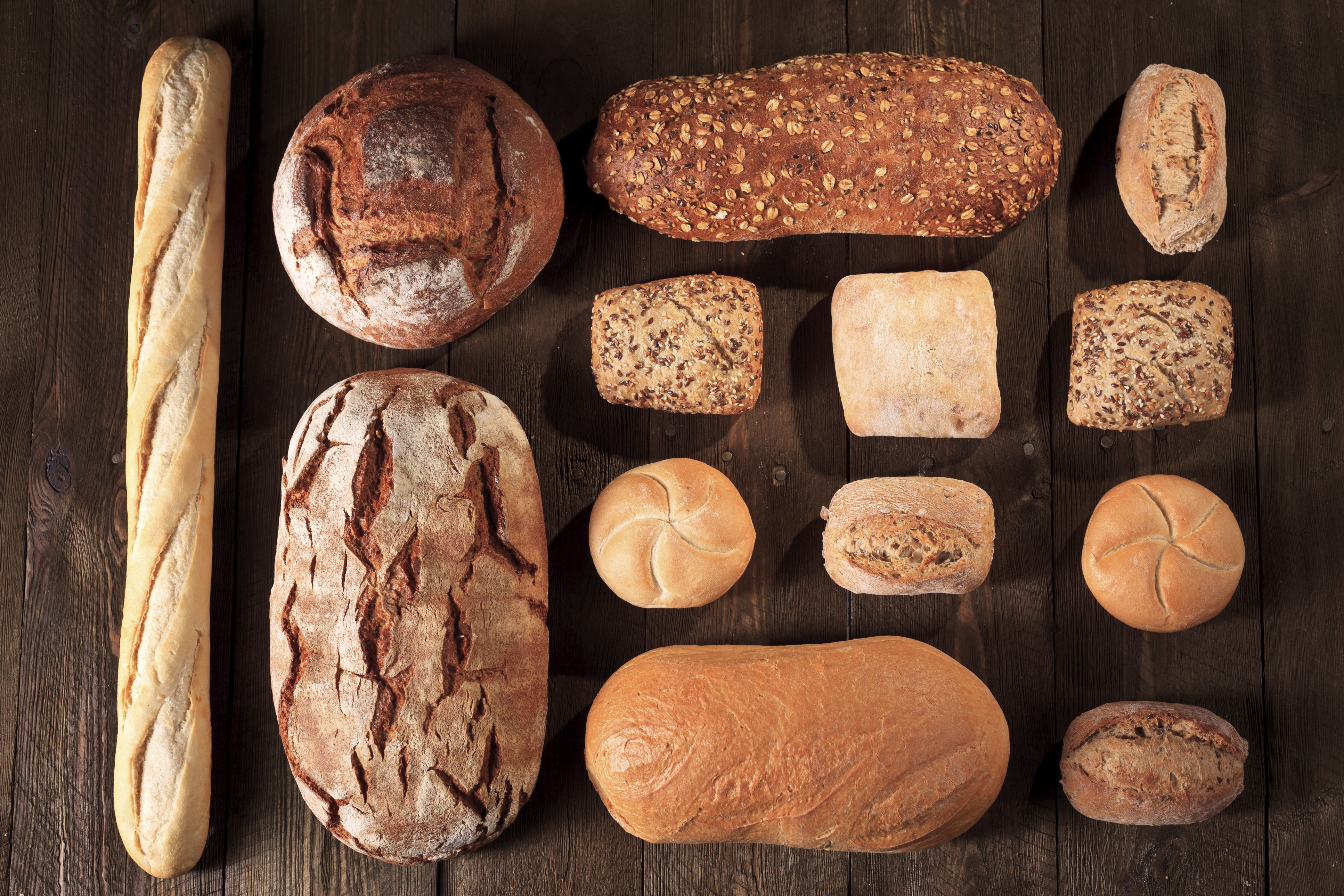 Variety of breads on wooden surface