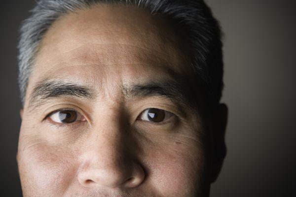 A close-up of an older man's eyes.