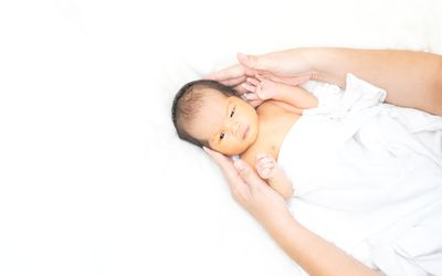 Cute newborn baby girl in white blanket