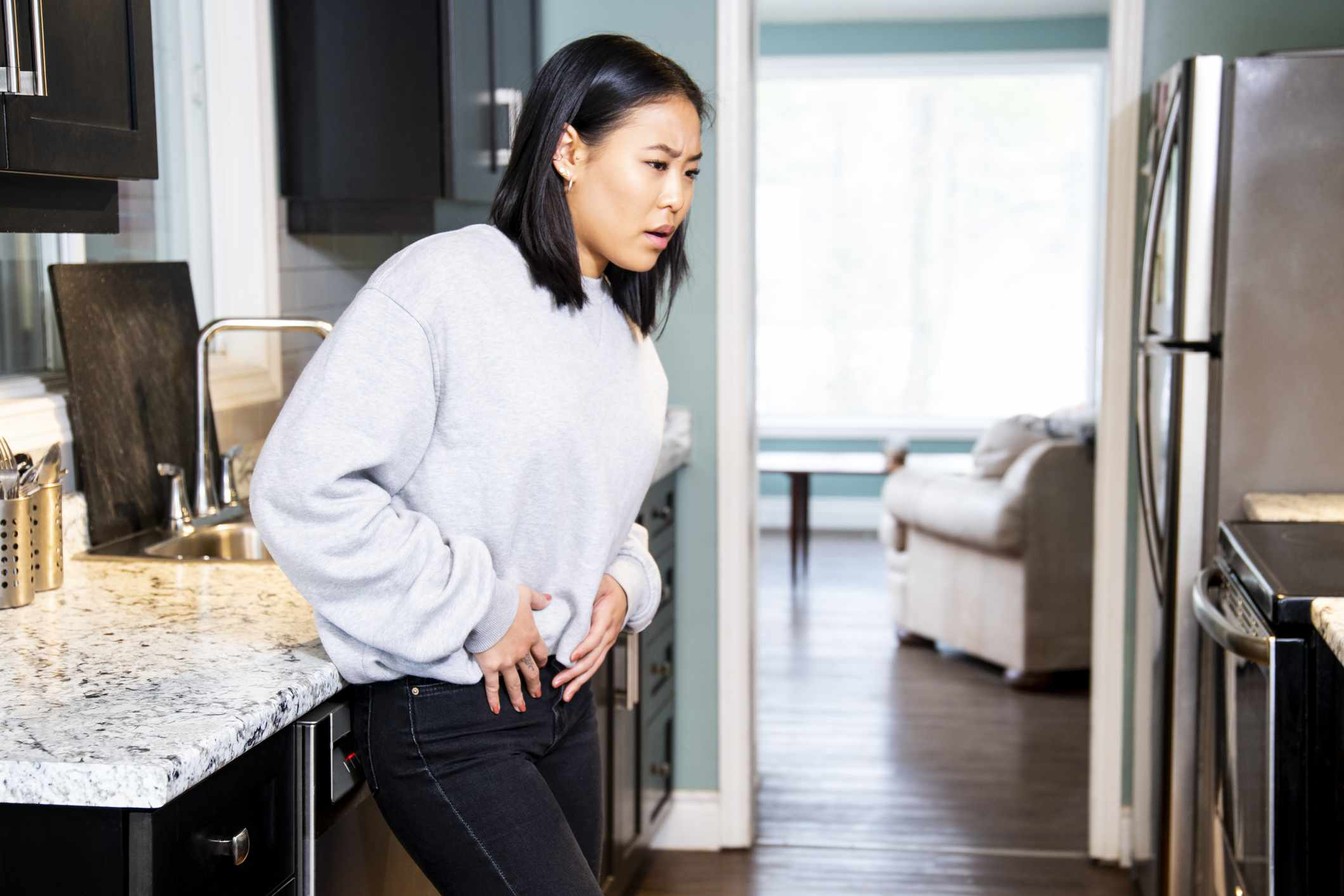woman experiencing pelvic pain