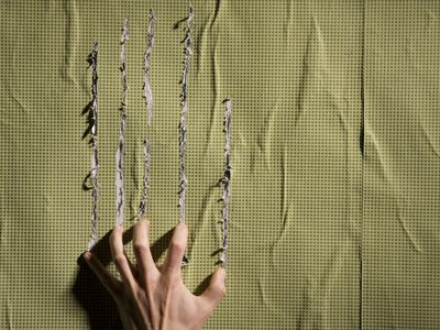 Person scratching a wall