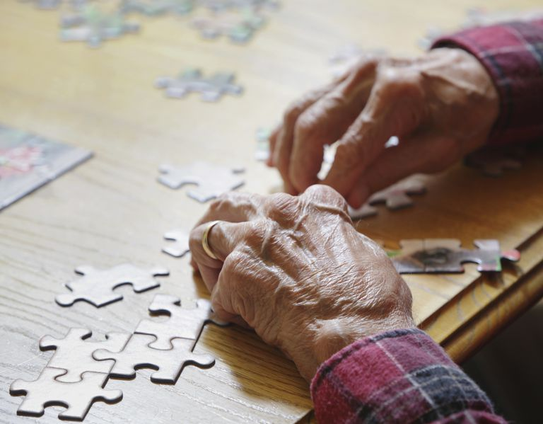 Man with Dementia Working on a Puzzle