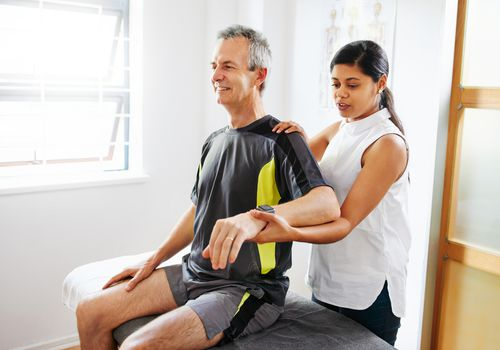 A man getting physical therapy for his shoulder