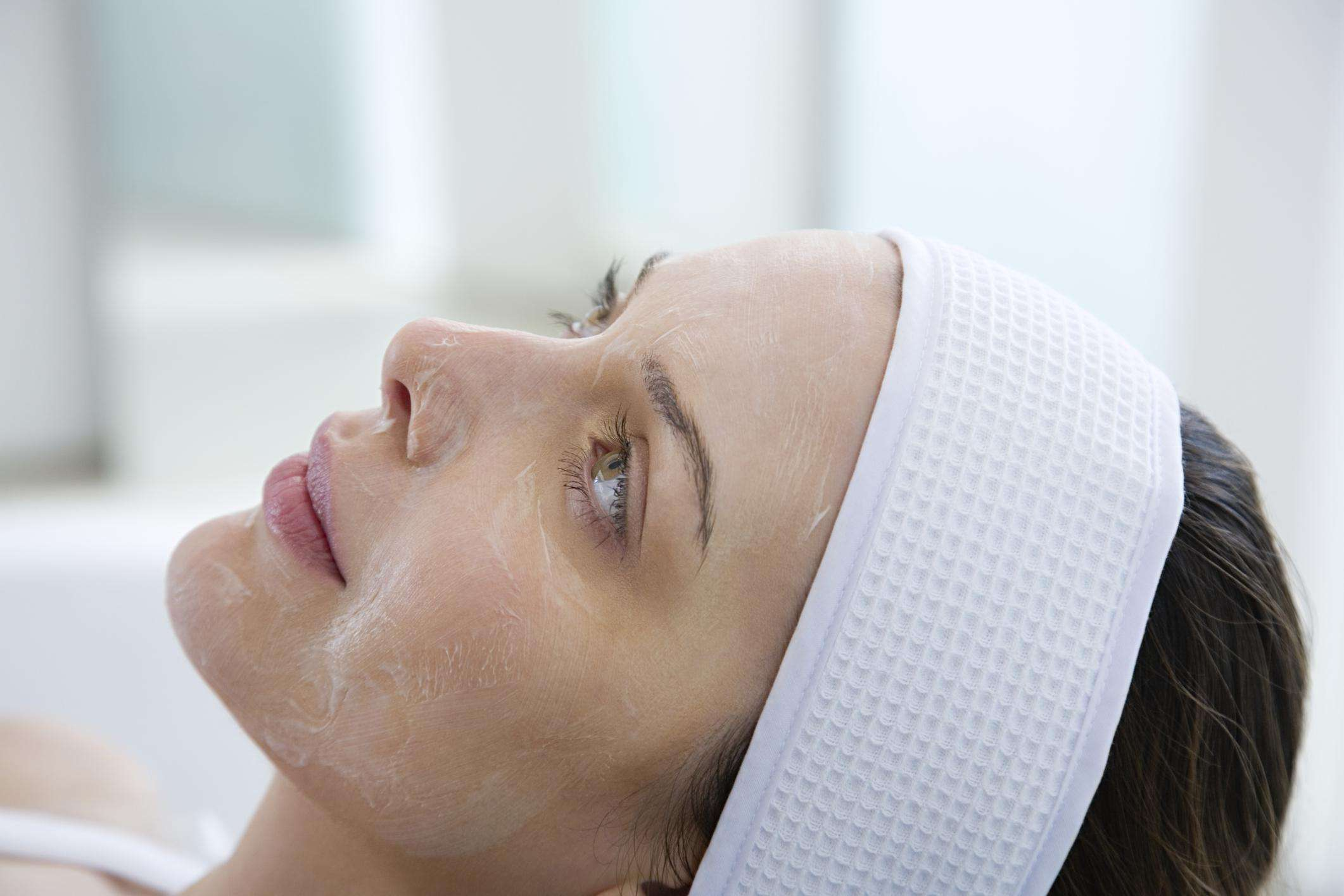 Woman getting a chemical peel facial treatment