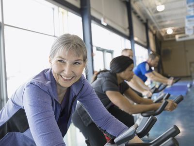 Smiling woman on exercise bike