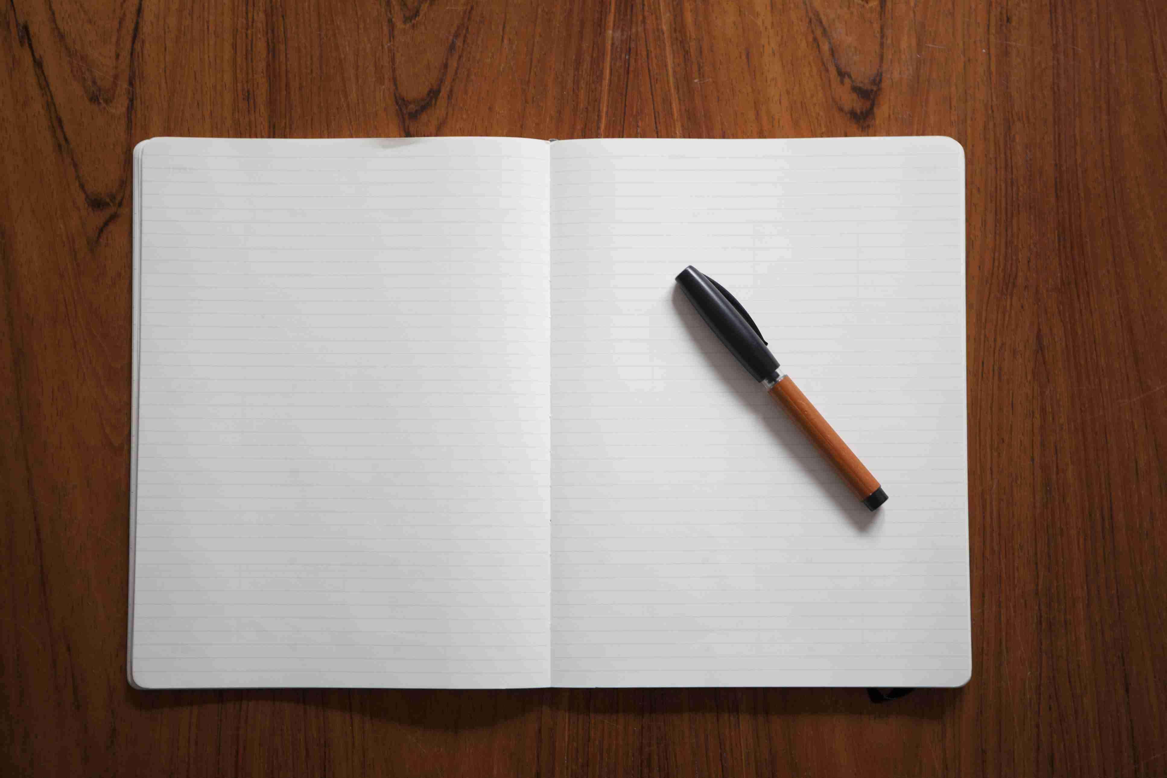 empty diary with pen