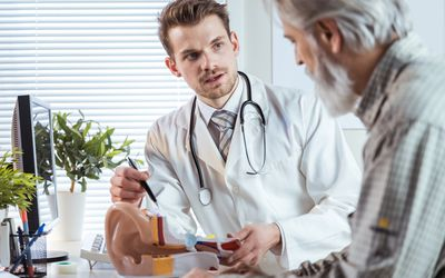 Doctor consultating patient about deafness