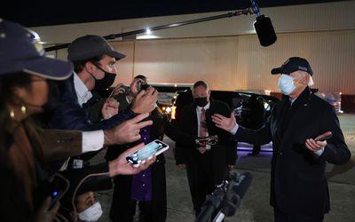 Joe Biden wears two masks while campaigning in Michigan