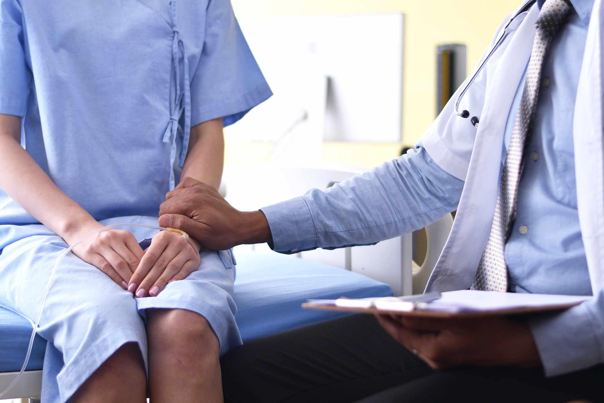 Doctor touching patient's arm in encouragement