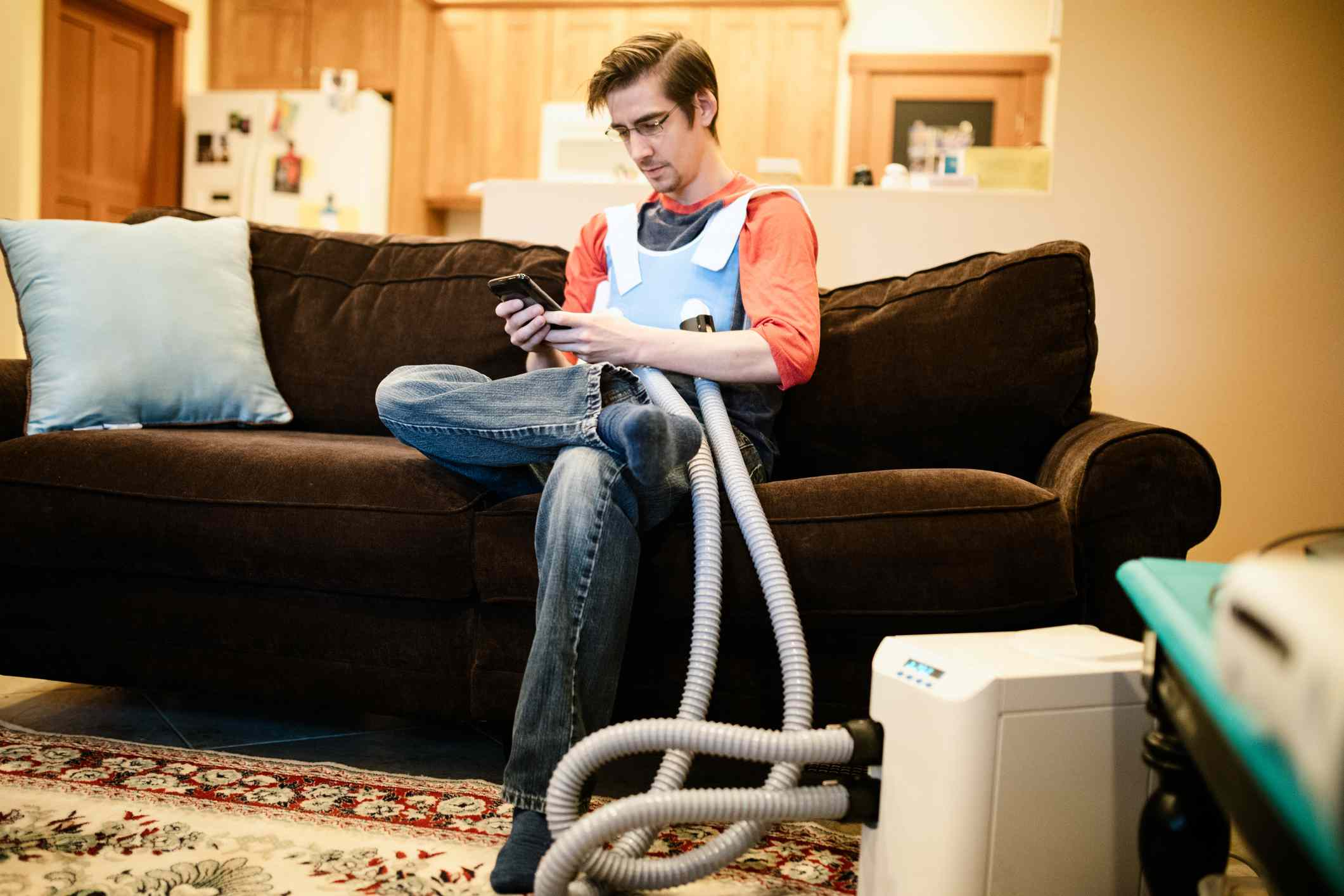 Man Using Inhaler Indoors