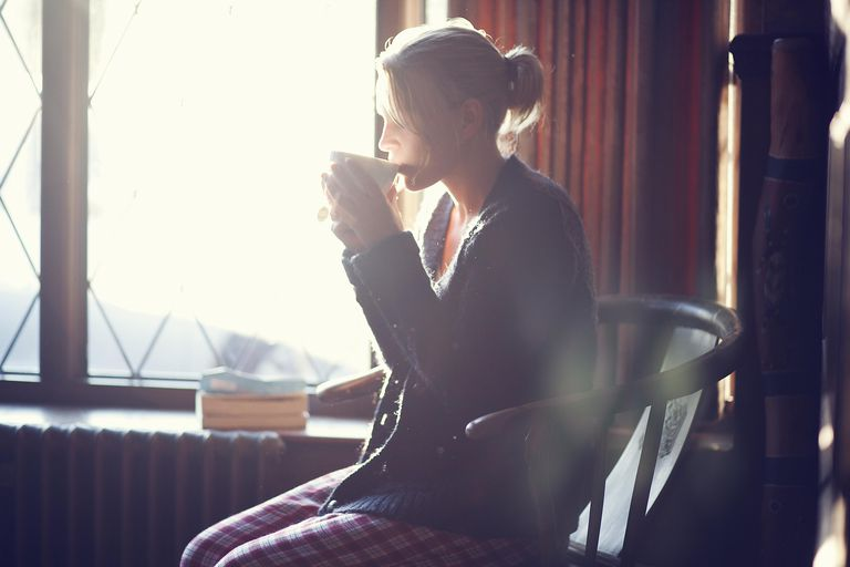 Young woman in her secret place drinking tea