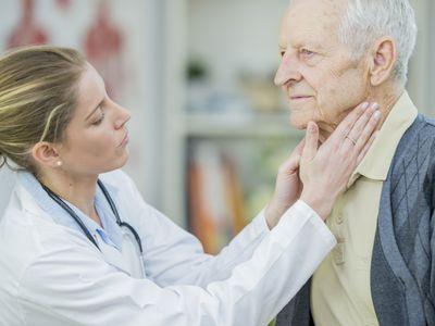 Woman checking man's lymph nodes