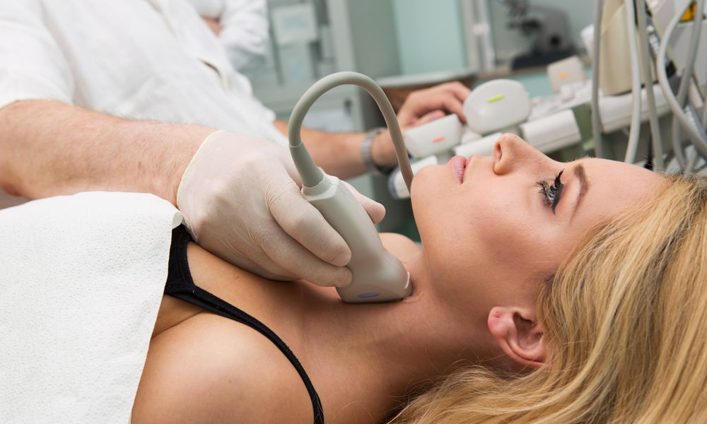 Woman getting a neck ultrasound.