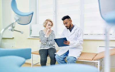 Woman discussing health issues with gynecologist