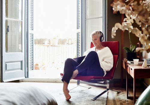 Woman listening to music on headphones