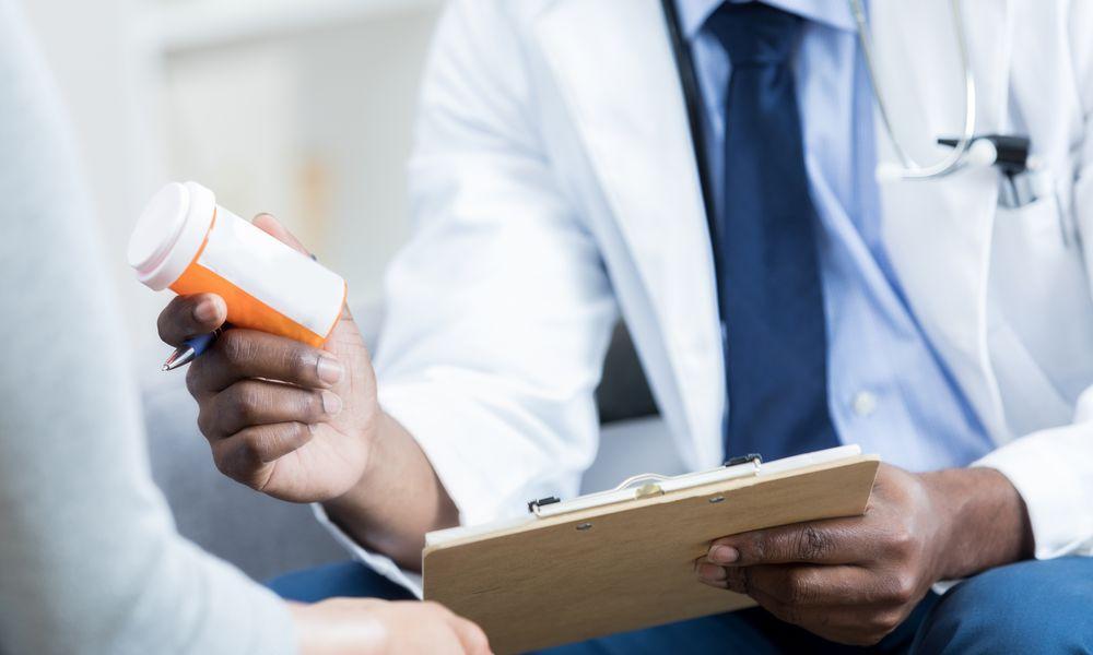 Unrecognizable doctor gives patient prescription medication