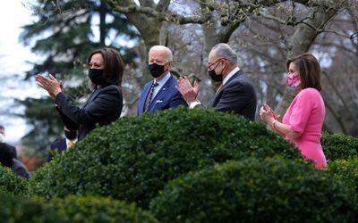 Kamala Harris, Joe Biden, Chuck Schumer, and Nancy Pelosi, wearing masks and making comments regarding the passage of the American Rescue Plan.